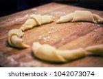making kifli rolls on wooden...   Shutterstock . vector #1042073074