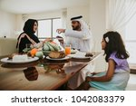 arabic happy family lifestyle... | Shutterstock . vector #1042083379