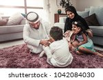 arabic happy family lifestyle... | Shutterstock . vector #1042084030