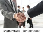 closeup.reliable handshake of... | Shutterstock . vector #1042093000