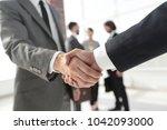 closeup.reliable handshake of... | Shutterstock . vector #1042093000