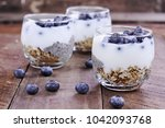 Small photo of Kefir yogurt and chia parfaits. Kefir is one of the top health foods available providing powerful probiotics. Extreme shallow depth of field.