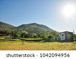 old greek village aya teodorio... | Shutterstock . vector #1042094956