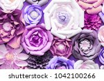 colorful paper flowers on wall. ...   Shutterstock . vector #1042100266