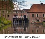 European watermill as a tourist attraction - stock photo