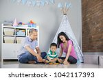 happy family playing at home... | Shutterstock . vector #1042117393