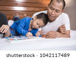 portrait of cheerful family... | Shutterstock . vector #1042117489