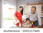 portrait of happy family... | Shutterstock . vector #1042117660