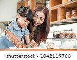 cute little girl and her... | Shutterstock . vector #1042119760