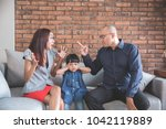 daddy arguing with his wife... | Shutterstock . vector #1042119889