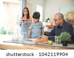 portrait of young asian family... | Shutterstock . vector #1042119904