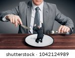 businessman holding fork with... | Shutterstock . vector #1042124989
