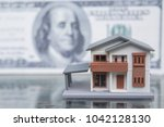miniature house toy with money... | Shutterstock . vector #1042128130