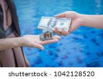 miniature house toy and money... | Shutterstock . vector #1042128520