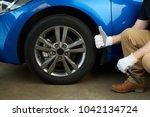 repaired car wheel. car... | Shutterstock . vector #1042134724