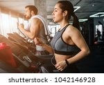 young man and woman are running ... | Shutterstock . vector #1042146928