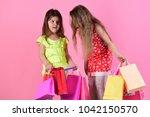 schoolgirls hold pink  red and... | Shutterstock . vector #1042150570