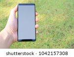 female hand holding the... | Shutterstock . vector #1042157308