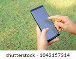 female hand holding the... | Shutterstock . vector #1042157314