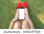 female red shoe hand holding... | Shutterstock . vector #1042157524