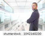 happy business man portrait at... | Shutterstock . vector #1042160230