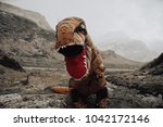 man with dinosaur costume in a...   Shutterstock . vector #1042172146