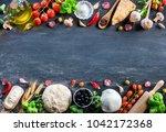 pizza ingredients on black... | Shutterstock . vector #1042172368