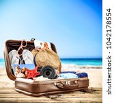 suitcase of brown color and... | Shutterstock . vector #1042178554