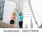 sportswomen stretching after... | Shutterstock . vector #1042179694