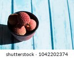 bowl and litchi  | Shutterstock . vector #1042202374