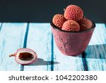 bowl and litchi  | Shutterstock . vector #1042202380