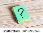 colorful question marks written ... | Shutterstock . vector #1042208263