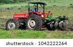 a farm worker in action. he... | Shutterstock . vector #1042222264