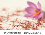one saffron flower and a lot of ... | Shutterstock . vector #1042231648