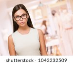 portrait of a  serious young... | Shutterstock . vector #1042232509