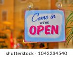 come in open sign | Shutterstock . vector #1042234540