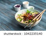 poke bowl with chopsticks and... | Shutterstock . vector #1042235140
