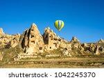hot air balloon overhanging... | Shutterstock . vector #1042245370