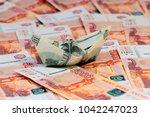 a boat built of hundred dollar... | Shutterstock . vector #1042247023