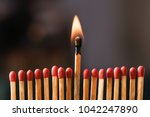 burning match among others on... | Shutterstock . vector #1042247890
