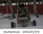 a snowmaker is at the bottom of ... | Shutterstock . vector #1042251574