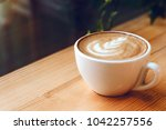 cup of cappuccino with... | Shutterstock . vector #1042257556