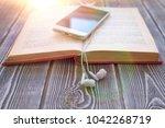 book  smartphone  headphones on ...
