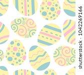 easter eggs vector pattern.... | Shutterstock .eps vector #1042269166