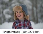 a little boy is wearing a... | Shutterstock . vector #1042271584