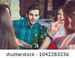 friends having a drinks in a...   Shutterstock . vector #1042283236