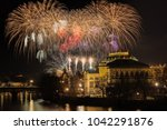 new year prague fireworks 2018... | Shutterstock . vector #1042291876