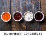 assorted sauces top view | Shutterstock . vector #1042305166