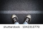 a teenager in jeans and canvas... | Shutterstock . vector #1042313770