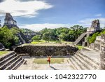 woman doing yoga at the tikal...   Shutterstock . vector #1042322770